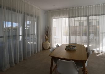Inverted pleat sheer from ceiling