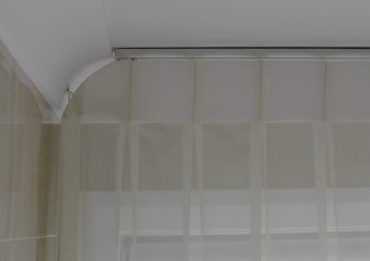 Inverted pleat sheer installed into ceiling