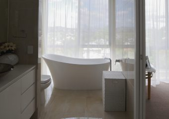 Sheer installed into ceiling as a back drop to a bath.