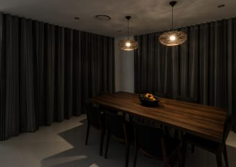 Patterned S fold sheers over blockout, double tracks from ceiling-closed lights on
