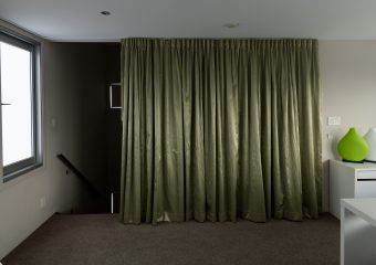Single pinch pleat curtain from the ceiling on a series 58 low profile track)