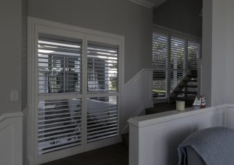 Double wide white timber shutters