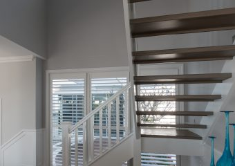 White timber shutters in double height void